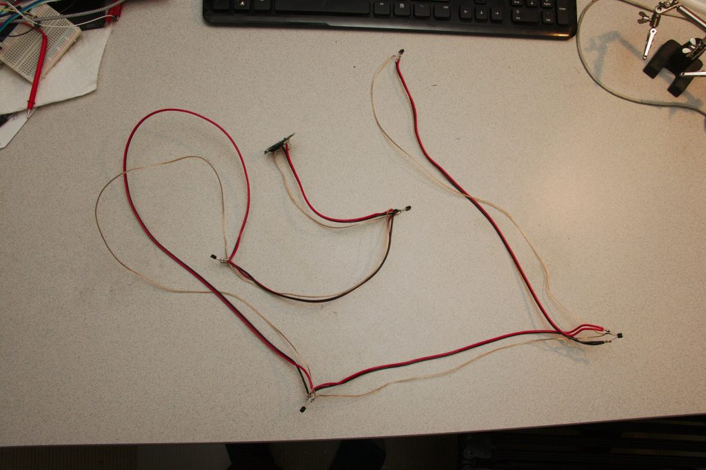 The whole wire with 5 sensors and the microcontroller layed out on a desk