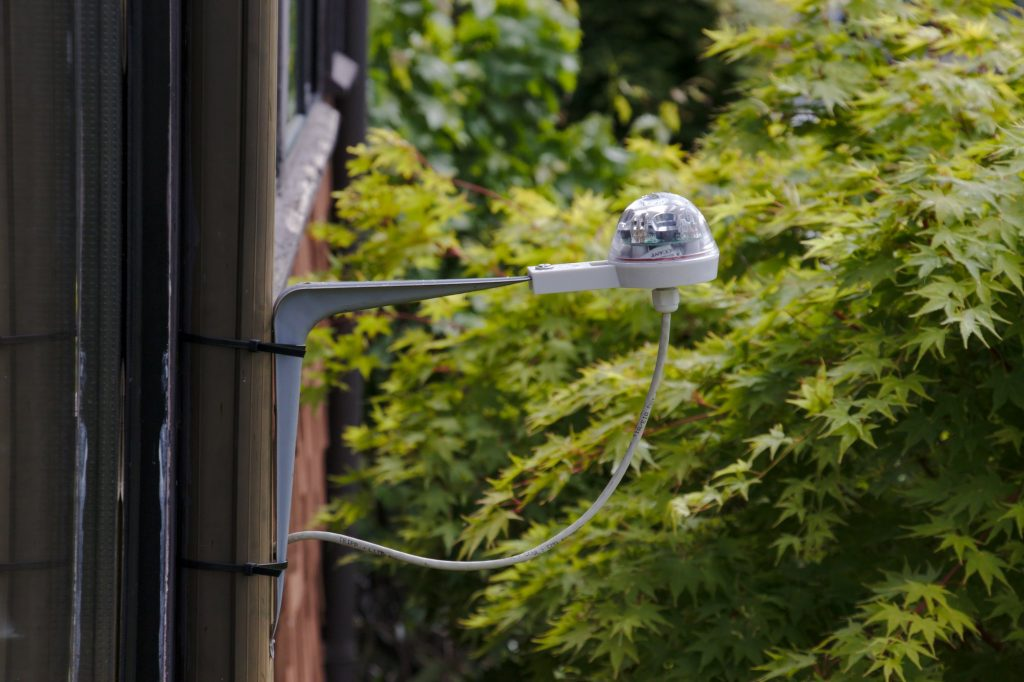 RG-11 rain sensor mounted temporarily on outside of house